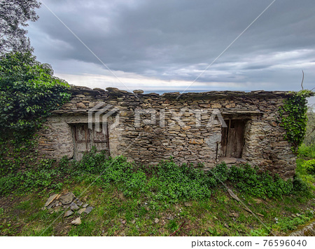 Old stone house by the sea hill in Liguria 76596040