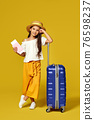 Happy little child girl in hat with pink suitcase 76598237