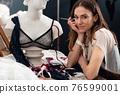 Woman lingerie designer sits at her desk 76599001