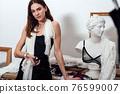 Portrait of a female fashion designer in her workshop 76599007