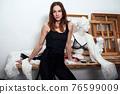 Portrait of a female fashion designer in her workshop 76599009