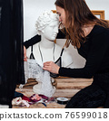 Young female fashion designer working on lingerie 76599018