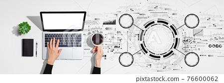 Tech circle with person using laptop computer 76600062