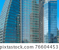 Pattern of office buildings windows. Glass architecture facade design with reflection in urban city, Downtown Dubai. Urban city in financial district with blue sky. 76604453