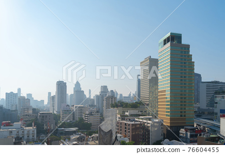 Aerial view of Bangkok Downtown Skyline, Thailand. Financial district and business centers in smart urban city in Asia. Skyscraper and high-rise buildings at noon with blue sky. 76604455