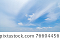Clear blue sky with white fluffy clouds at noon. Day time. Abstract nature landscape background. 76604456