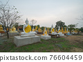 Row of Buddha statues. Old ruins of a temple in Wat Phai Rong Wua temple, Song Phi Nong, Suphan Buri. Famous tourist attraction landmark. Thai History architecture. 76604459