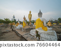 Row of Buddha statues. Old ruins of a temple in Wat Phai Rong Wua temple, Song Phi Nong, Suphan Buri. Famous tourist attraction landmark. Thai History architecture. 76604464