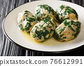 Strangolapreti, Italian Gnocchi Made with Bread and spinach close-up in a plate. Horizontal 76612991