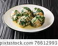 Italian Strangolapreti spinach dumplings with butter sage sauce close-up on a slate board. horizontal 76612993