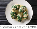 Italian Bread gnocchi with spinach known as Strangolapreti close-up in a plate. Horizontal top view 76612996