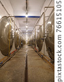 Hall with large metal tanks for fermenting beer 76615105