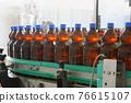 Bottles with beer on conveyor 76615107