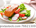 Salmon fish fillet grilled and vegetable salad with radish, tomato, green pepper, broccoli and asparagus. 76621309