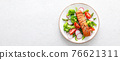Salmon fish fillet grilled and vegetable salad with radish, tomato, green pepper, broccoli and asparagus on white background. Banner. 76621311