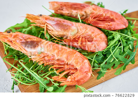 Red raw prawns, close up. Fresh shrimps with rucola. Seafood background 76622829