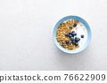 Granola with yogurt and blueberry 76622909
