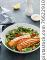 Grilled salmon fillet and fresh vegetable salad. Mediterranean diet. 76622910
