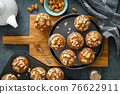 Healthy gluten free almond muffins with nut slices 76622911