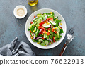 Vegetarian fresh vegetable organic salad with cucumber, red bell pepper, red onion, corn and green lettuce 76622913