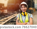 Happy women engineer Asian worker female work in factory portrait smile standing arm fold confidence look 76627040