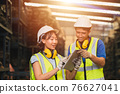 Asian young man and women worker team engineer working help support together using tablet happy smile to work in factory industry 76627041