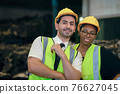 Couple friend Team Worker mix race  enjoy working in heavy factory standing together happy smiling portrait shot looking camera 76627045