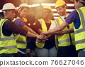 Engineer Teamwork Concept,Worker team join hands together in factory. People joining for cooperation success business of engineering partnership agreement of Architect engineer contractor mix race 76627046