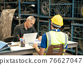 Factory manager looking at the paper with young engineer sitting front for call for blaming or consider and interview job apply or solving working problem report situation at factory work 76627047