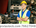 confident Asian male engineer worker standing arm crossed happy smile for enjoy working in factory 76627048