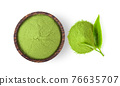 powdered matcha green tea in bowl isolated on white background 76635707