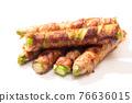 Serve asparagus rolls on a plate 76636015