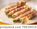 Asparagus meat-wrapped frying pan cooking scene 76636016