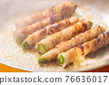 Asparagus meat-wrapped frying pan cooking scene 76636017