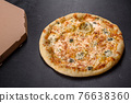 Tasty fresh oven pizza with tomatoes, cheese and mushrooms on a dark concrete background 76638360