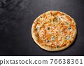 Tasty fresh oven pizza with tomatoes, cheese and mushrooms on a dark concrete background 76638361