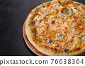 Tasty fresh oven pizza with tomatoes, cheese and mushrooms on a dark concrete background 76638364