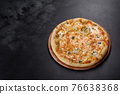Tasty fresh oven pizza with tomatoes, cheese and mushrooms on a dark concrete background 76638368