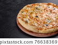 Tasty fresh oven pizza with tomatoes, cheese and mushrooms on a dark concrete background 76638369