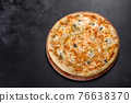 Tasty fresh oven pizza with tomatoes, cheese and mushrooms on a dark concrete background 76638370