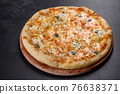 Tasty fresh oven pizza with tomatoes, cheese and mushrooms on a dark concrete background 76638371