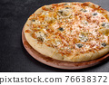 Tasty fresh oven pizza with tomatoes, cheese and mushrooms on a dark concrete background 76638372