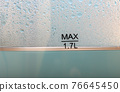 A water in an kettle with transparent walls, close up. 76645450