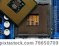 close-up of a printed circuit board with microchips and radio parts with a processor. Background for electronics 76650709