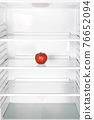 apple in the refrigerator 76652094