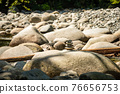 Small stone tower on dried waterway of montailn river 76656753