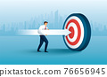 Businessman aims with huge arrow. achievement goal. Aim in business concept 76656945