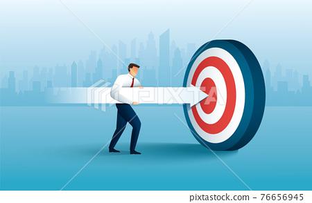 Businessman aims with huge arrow. achievement goal. Aim in business concept 76656945