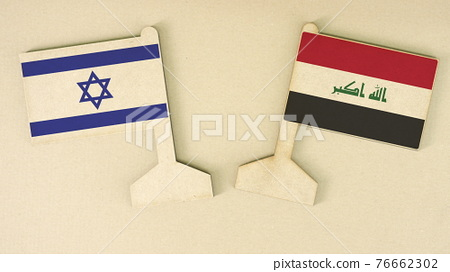 Flags of Israel and Iraq made of recycled paper on the cardboard desk, flat layout 76662302