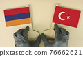 Holding flags of Armenia and Turkey made of recycled paper on the cardboard table 76662621